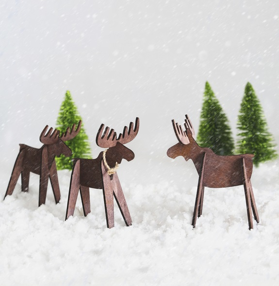 Wooden reindeer in snow